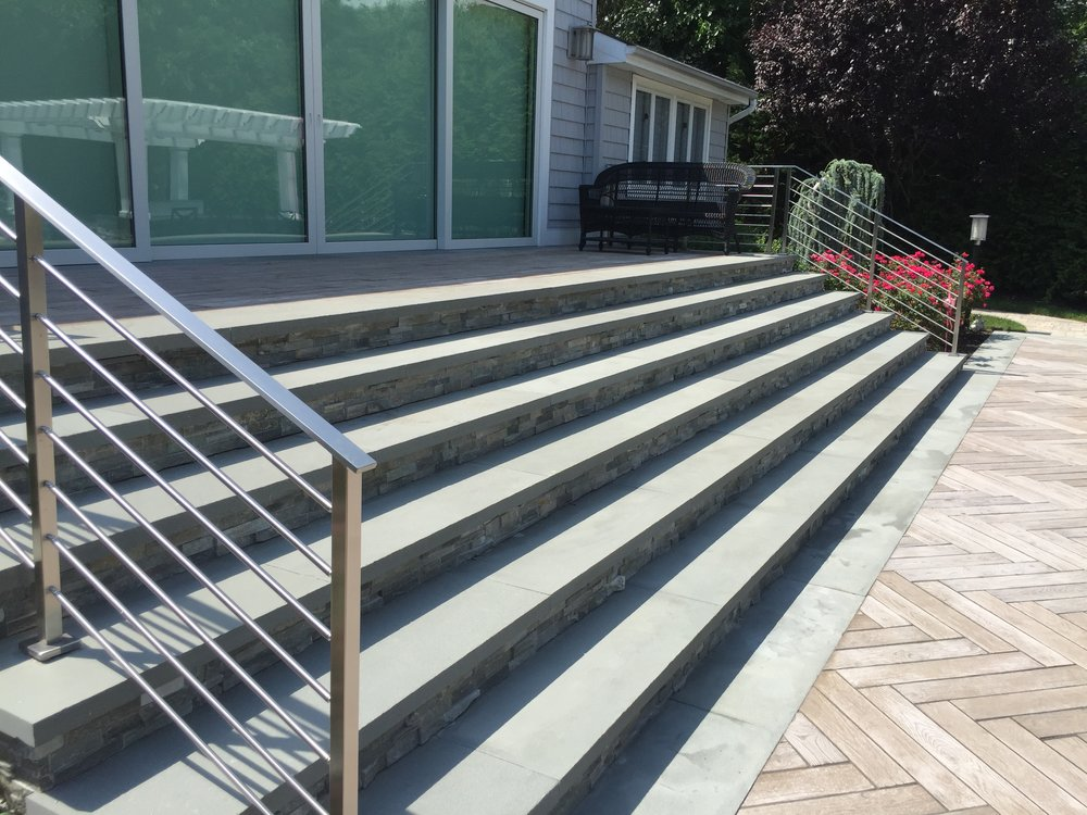 Professional landscape design with railings in Long Island, NY