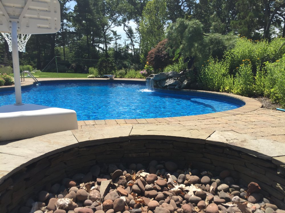Top landscape design company with fire pit in Long Island, NY