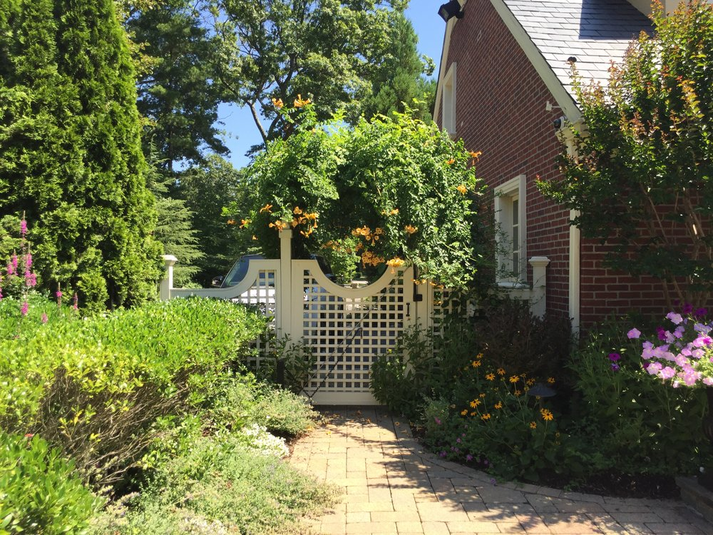 Professional landscape design company with vinyl fence gate in Long Island, NY
