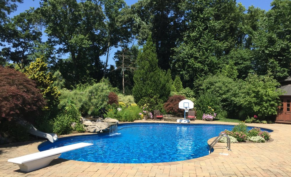 Top landscape design company with pool area in Long Island, NY