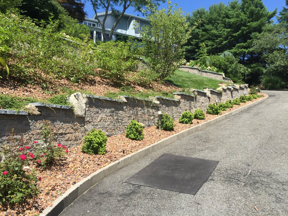 Landscaping design with plantings in Long Island, NY