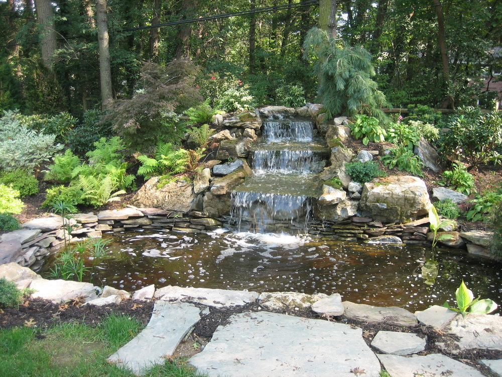 Top natural stone pond landscape design in Long Island, NY