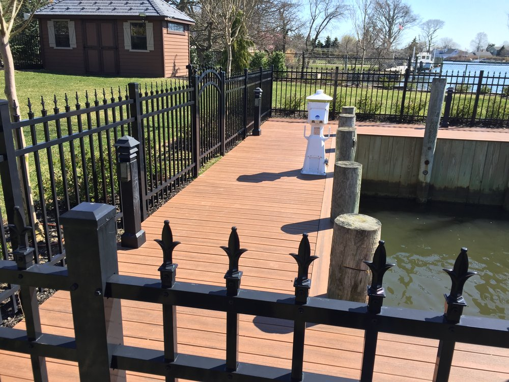 Professional landscape design with aluminum fences in Long Island, NY