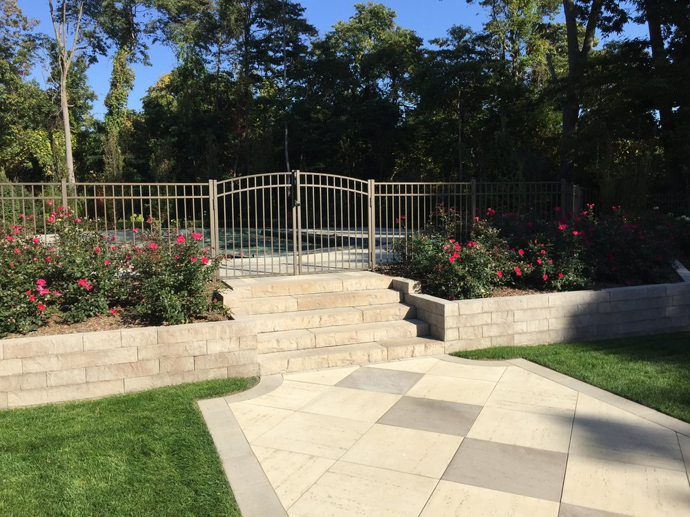 Top landscape design with a fence in Long Island, NY