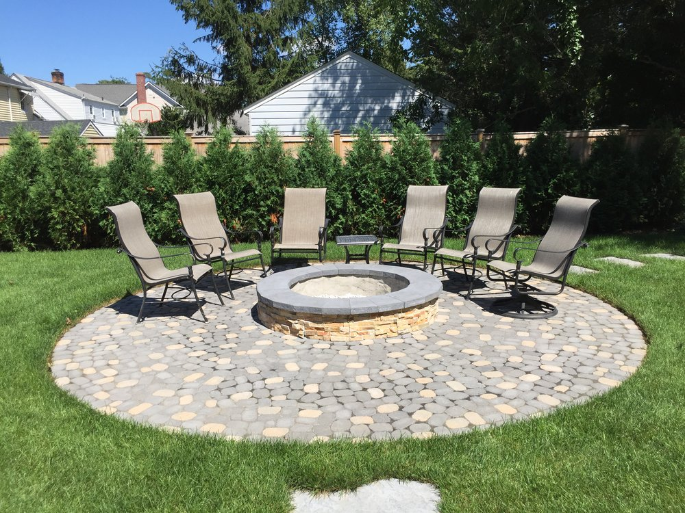 Landscape design with fire feature in Long Island, NY