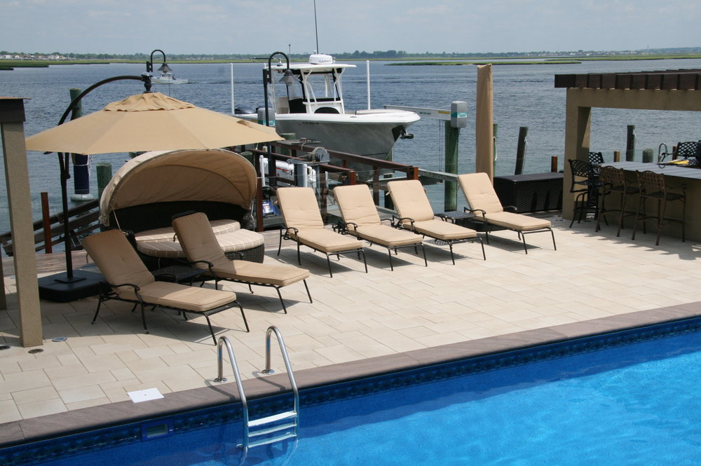 Professional landscape design with a pool patio in Long Island, NY