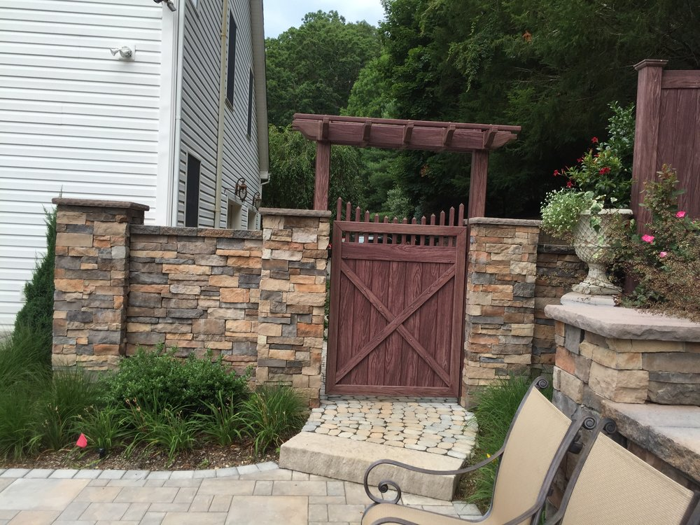 Professional landscape design with a cedar fences in Long Island, NY