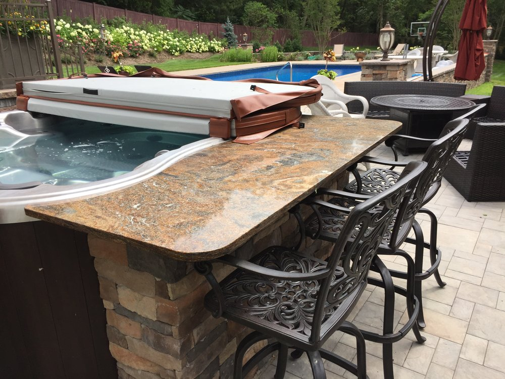 Professional landscape design with a hot tub in Long Island, NY