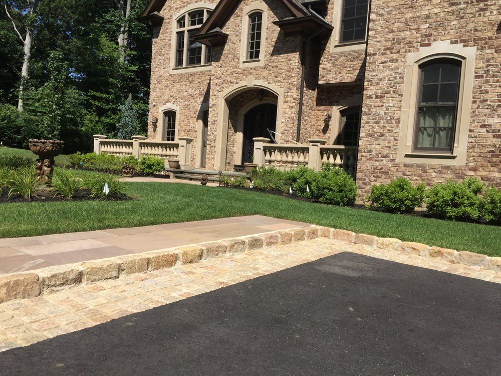 Landscape design with natural stone driveway in Long Island, NY
