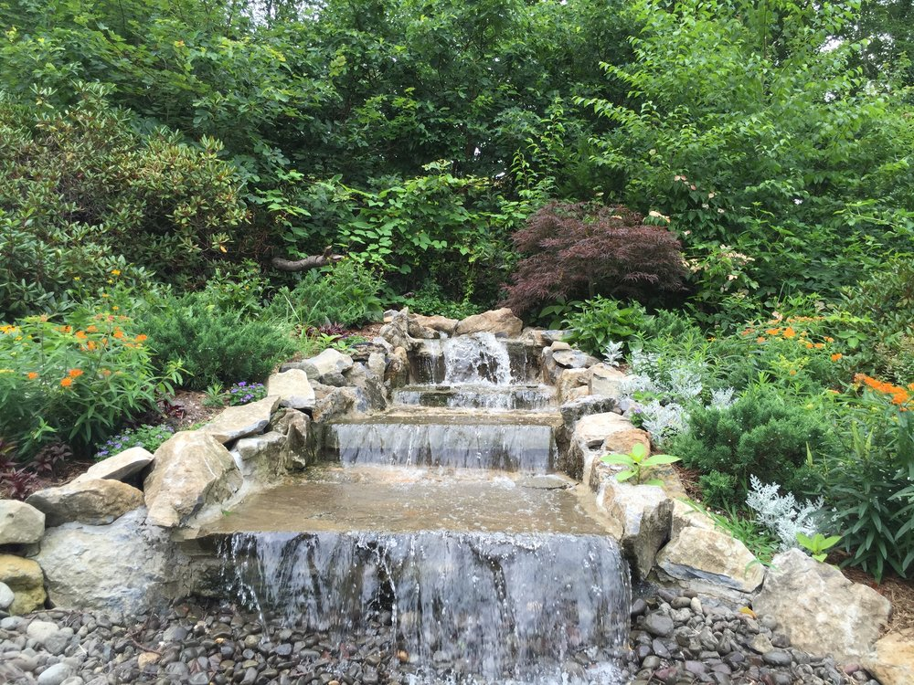Landscape design with waterfall in Long Island, NY