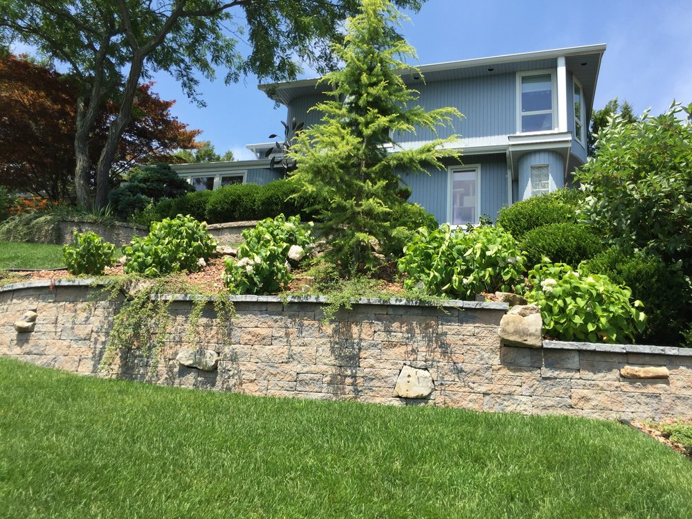 Landscape design with retaining wall in Long Island, NY