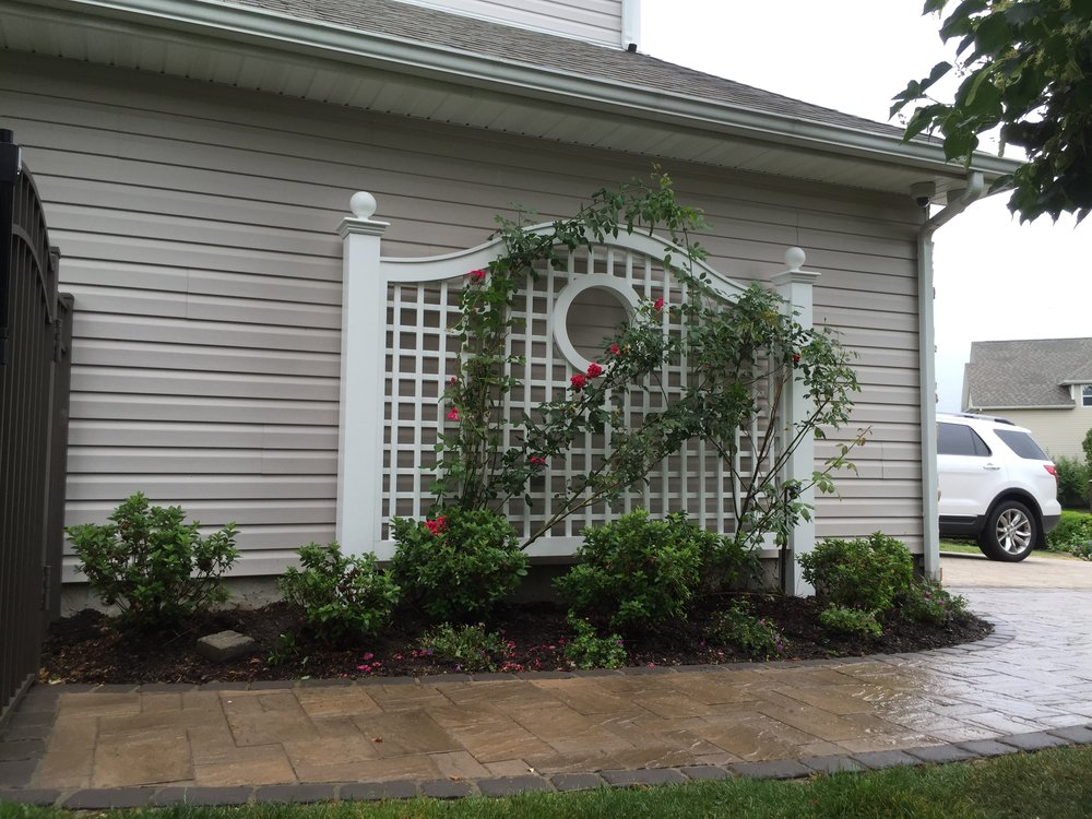 Landscape design with trellis in Long Island, NY