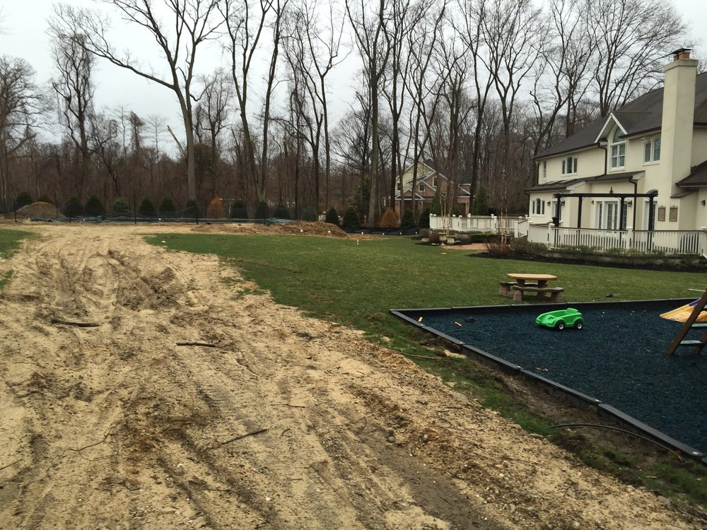 Professional landscape design with a paved pool in Long Island, NY
