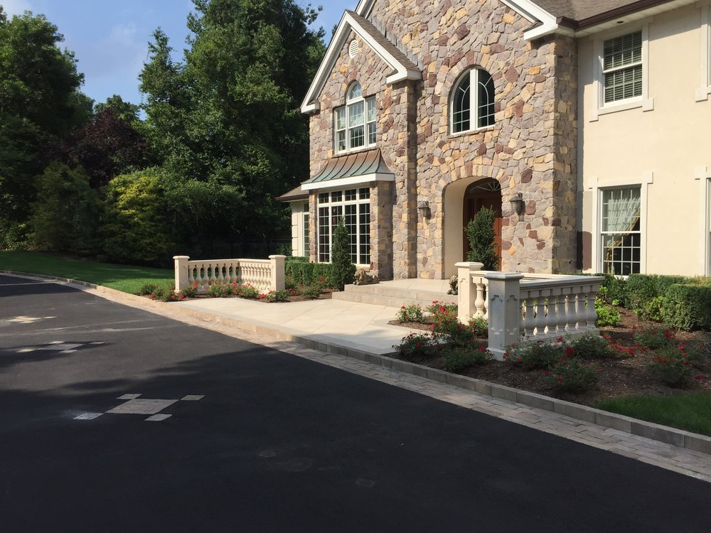 Professional landscape design with a paved walkway in Long Island, NY