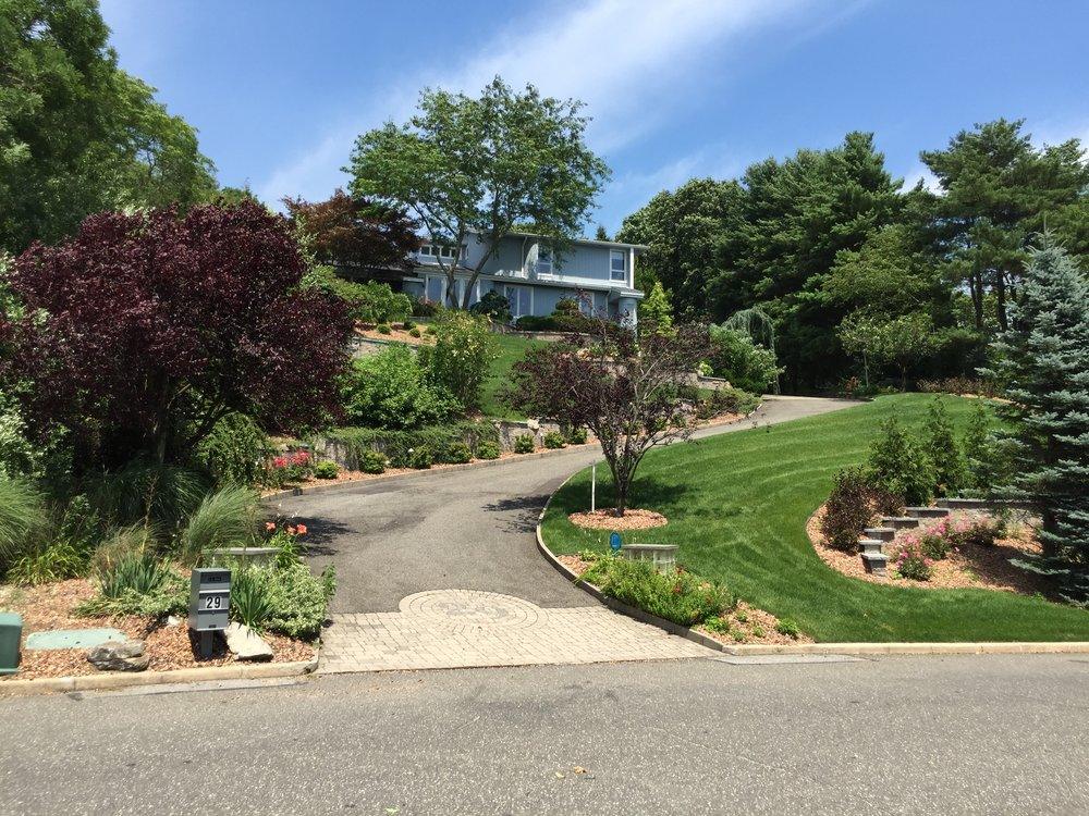 Landscape design with paved driveway in Long Island, NY