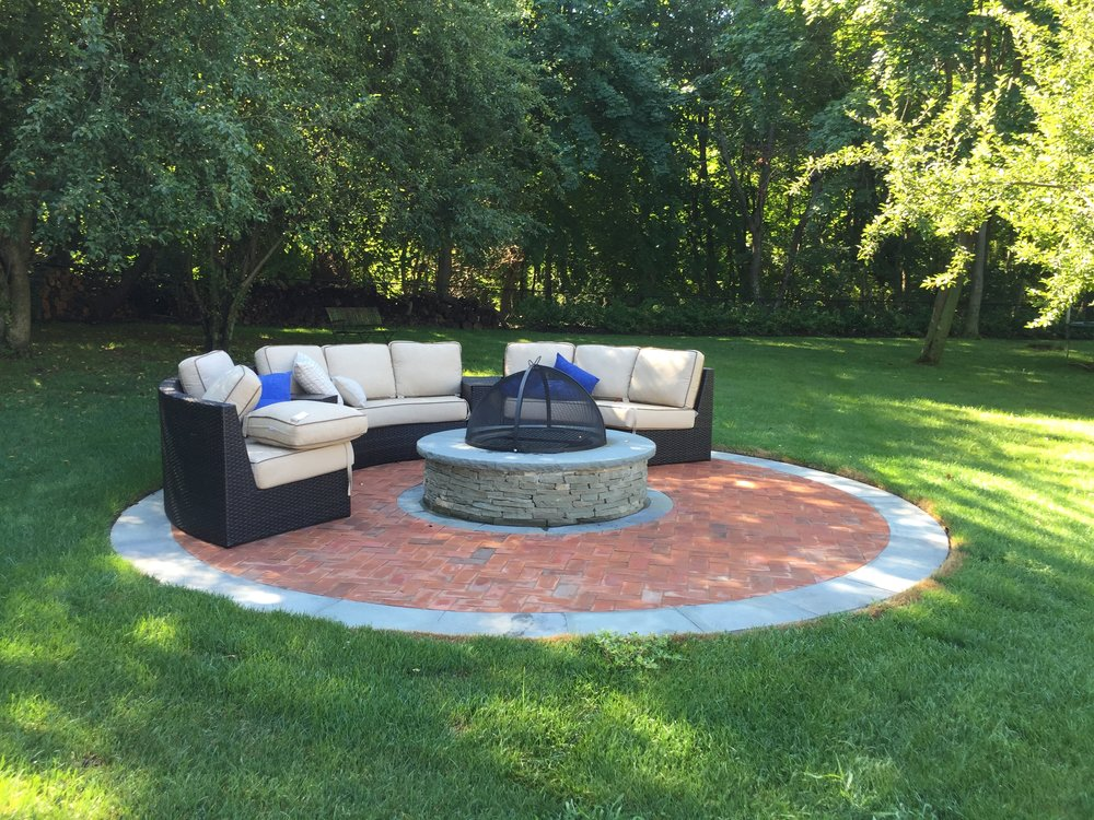 Top natural stone fire pit landscape design company in Long Island, NY