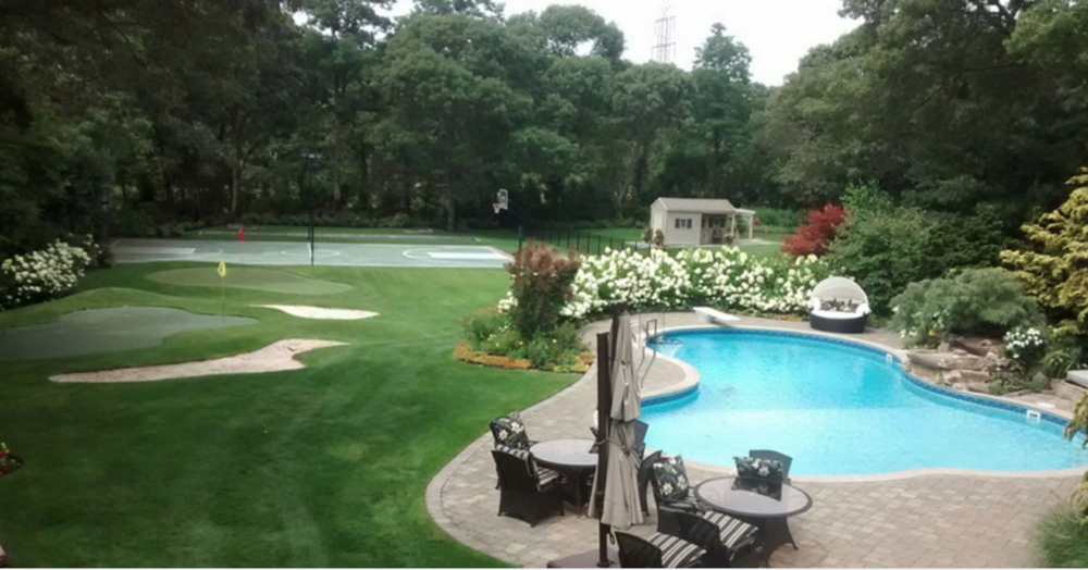 Professional landscape design company with tennis court in Long Island, NY