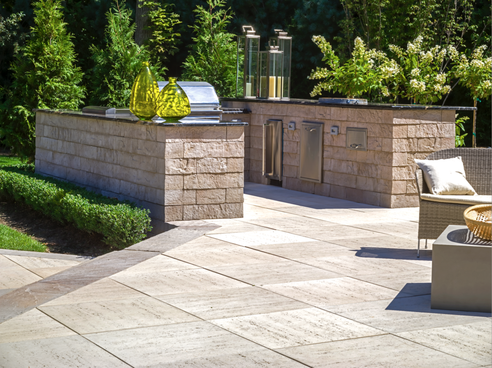 Professional landscape design with an outdoor kitchen in Long Island, NY