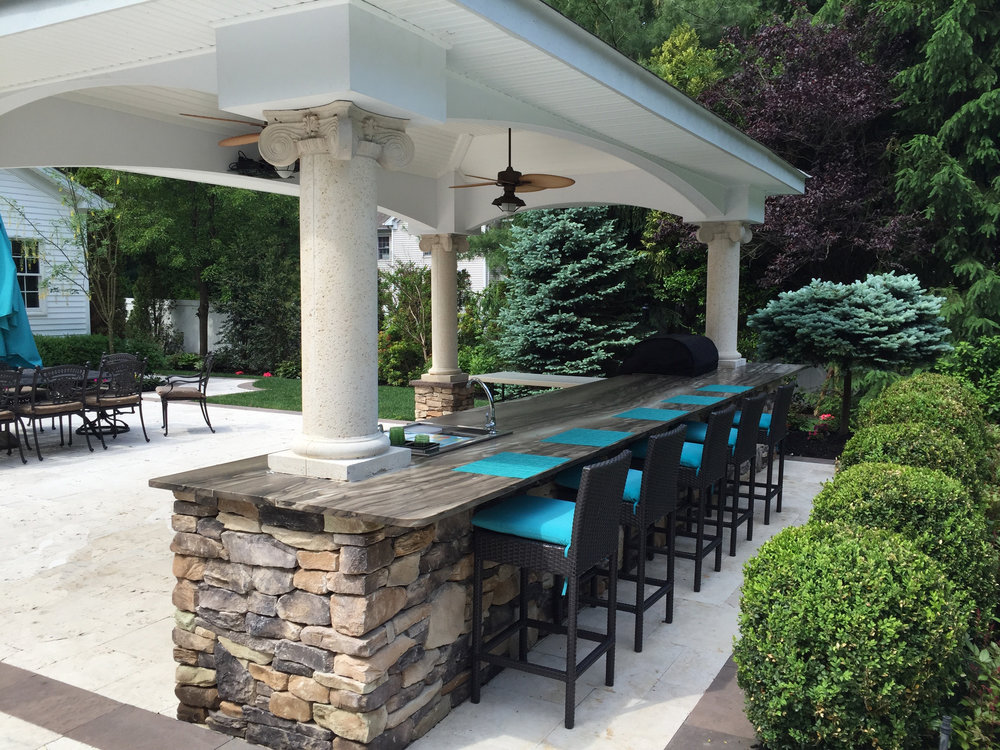 Landscape design with pool house kitchen in Long Island, NY