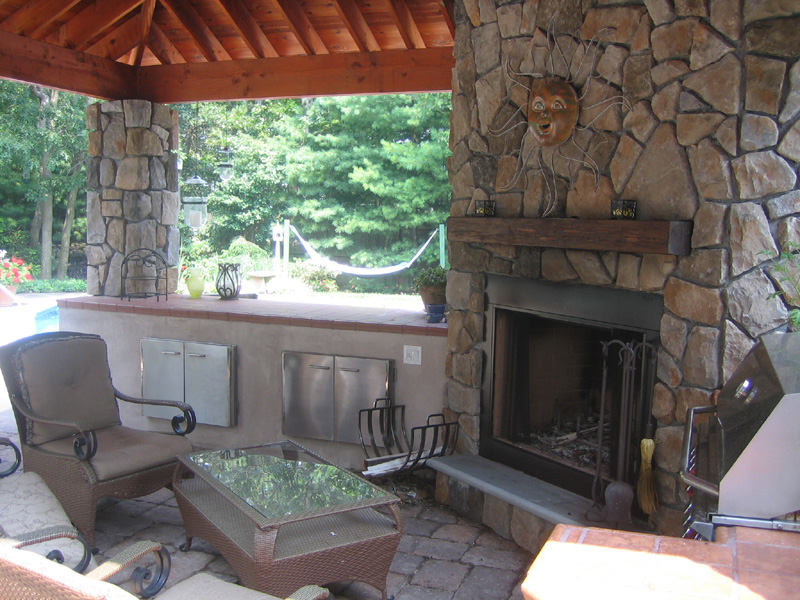 Professional landscape design with an outdoor fireplace in Long Island, NY
