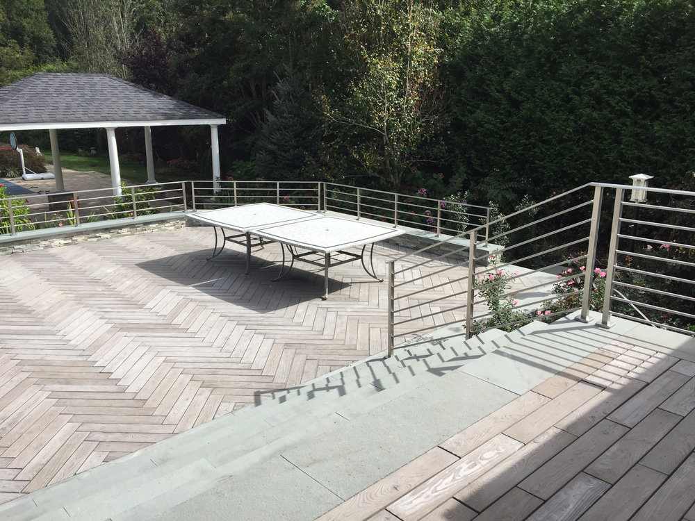 Professional landscape design with aluminum railing in Long Island, NY