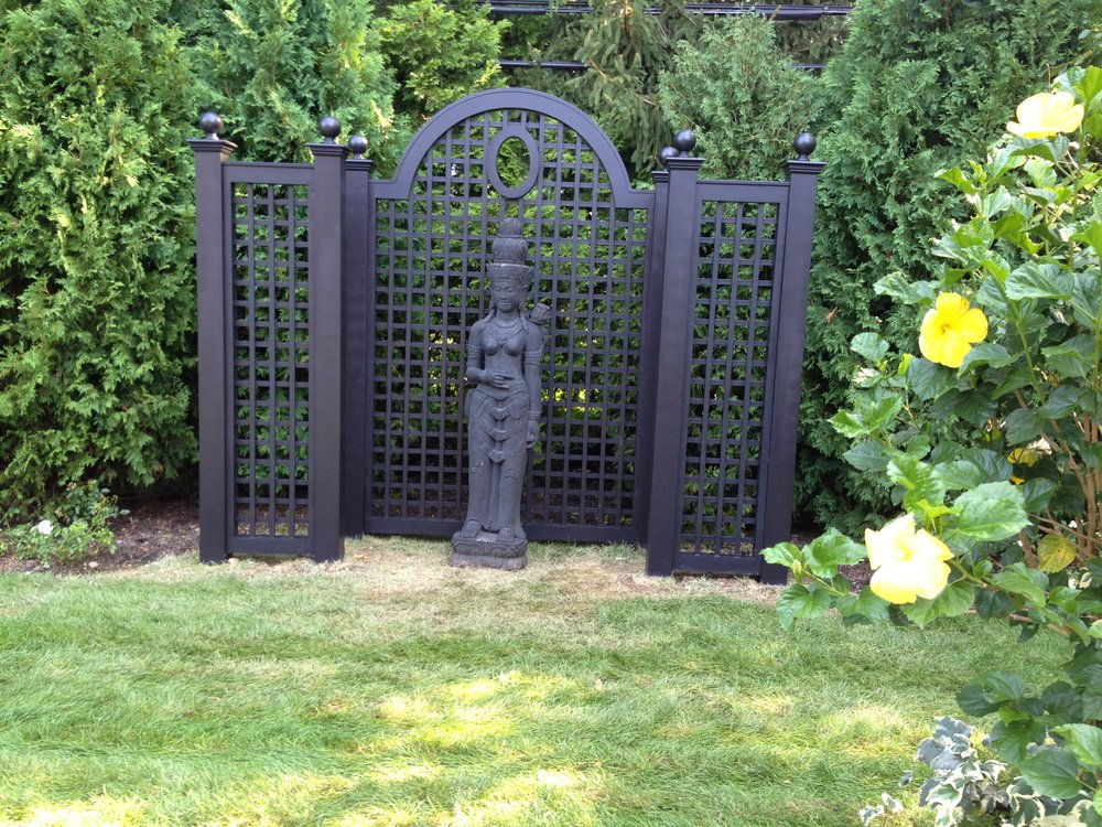Top cedar fence landscape design company in Long Island, NY