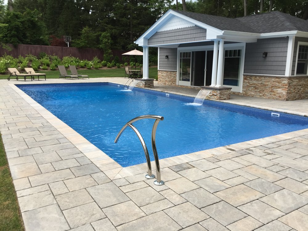 Landscape design with pool deck  in Long Island, NY
