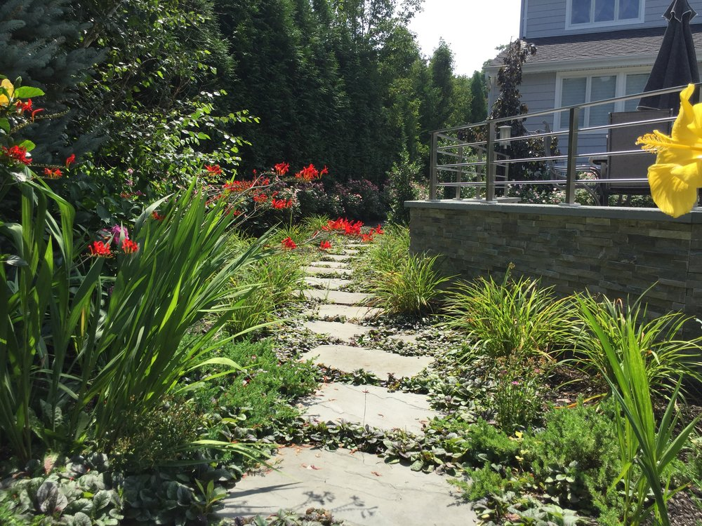 Landscape design with walkway in Long Island, NY