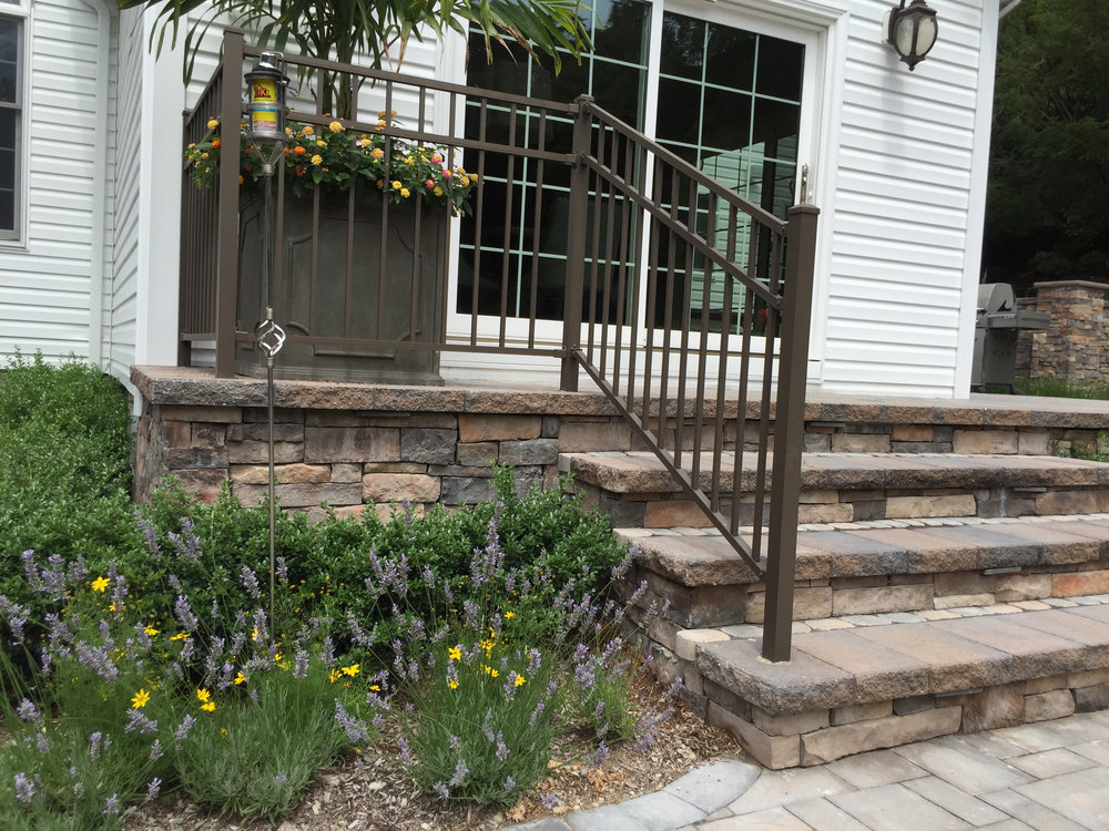 Top landscape design with railings in Long Island, NY