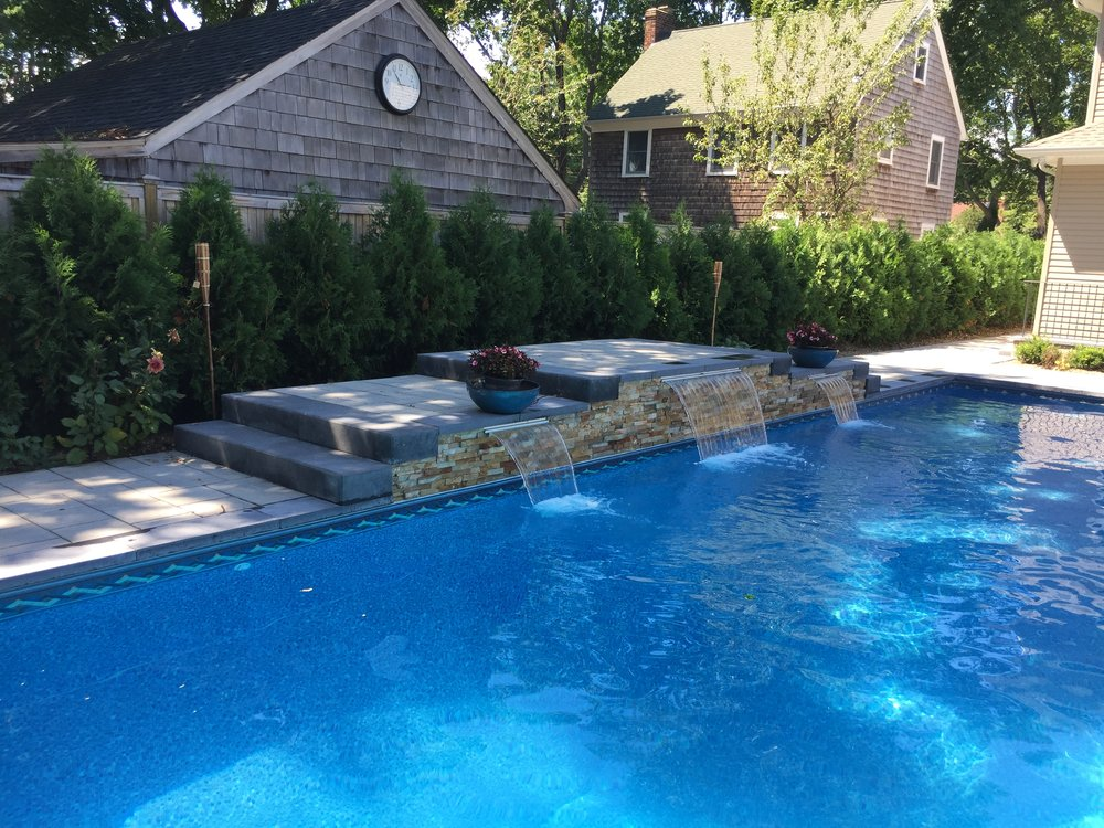 Landscape design with outdoor pool in Mt. Sinai, NY