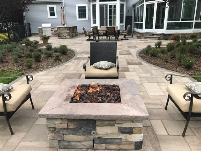 Landscape design with outdoor fireplace in Long Island, NY