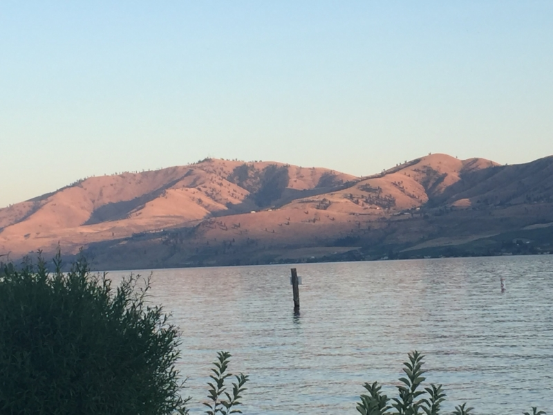 Picture of Lake Chelan at dusk with hills in background.