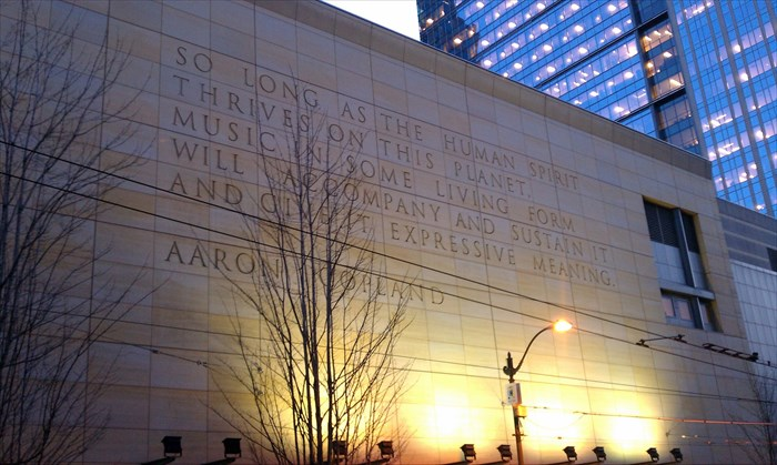 Side of Benaroya Concert hall in Seattle, with an Aaron Copland quote