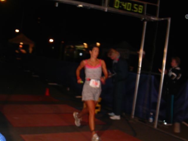Not-such-serious business. Crossing line at 2005 ironman, wearing a nighty from Ross Dress for Less. Jesse taught me how to dress for success.