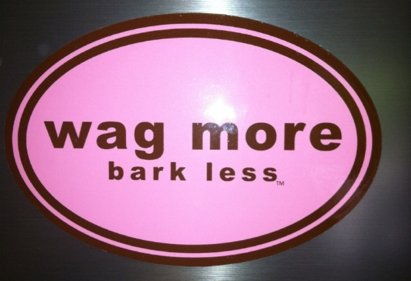 "Sticker that says ""wag more bark less"""