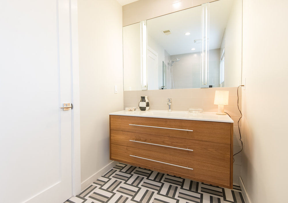 Master bath features custom cabinets, high-end fixtures and tile.