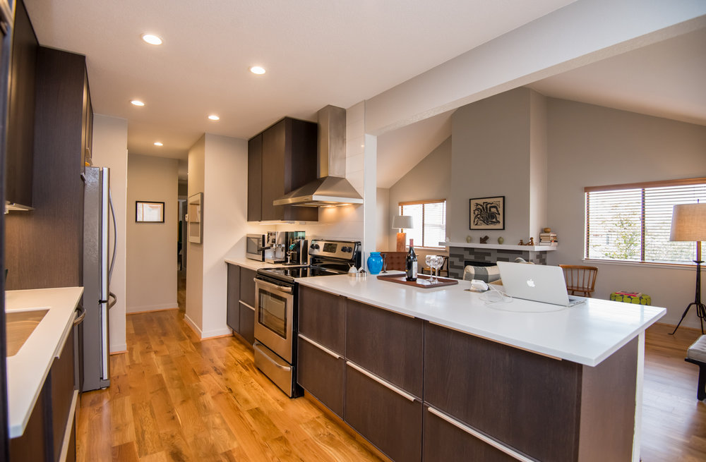 Kitchen with new cabinets, undercounter lighting, stainless steel appliances and more.