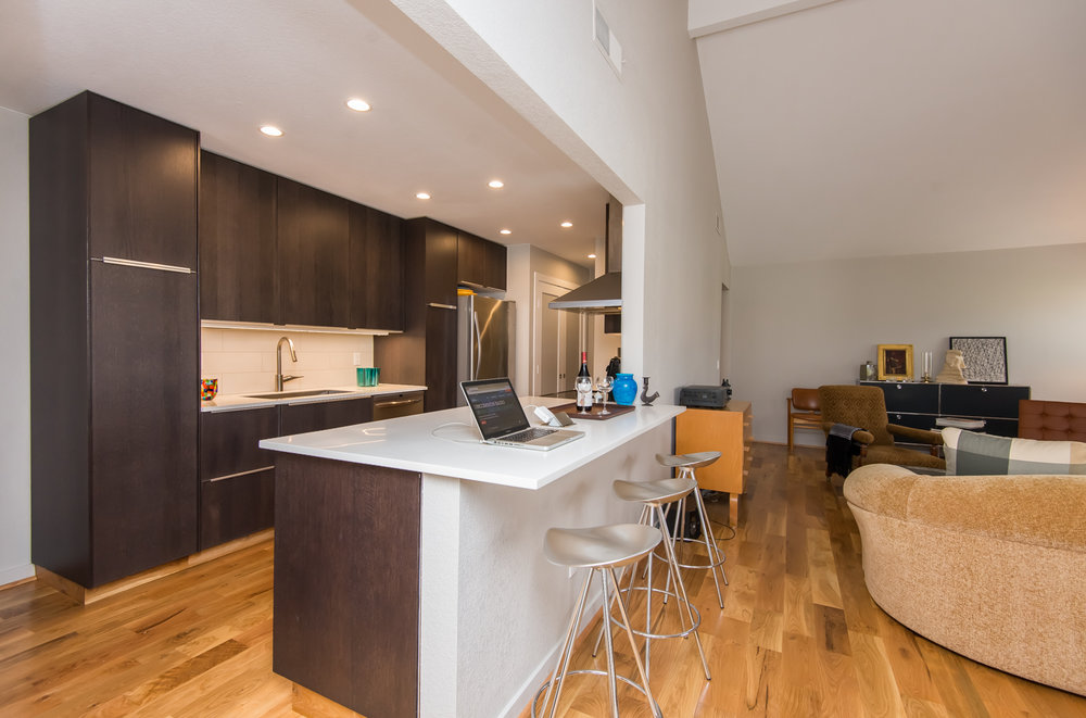 Chef's kitchen with bar looks onto living areas. Perfect for entertaining.