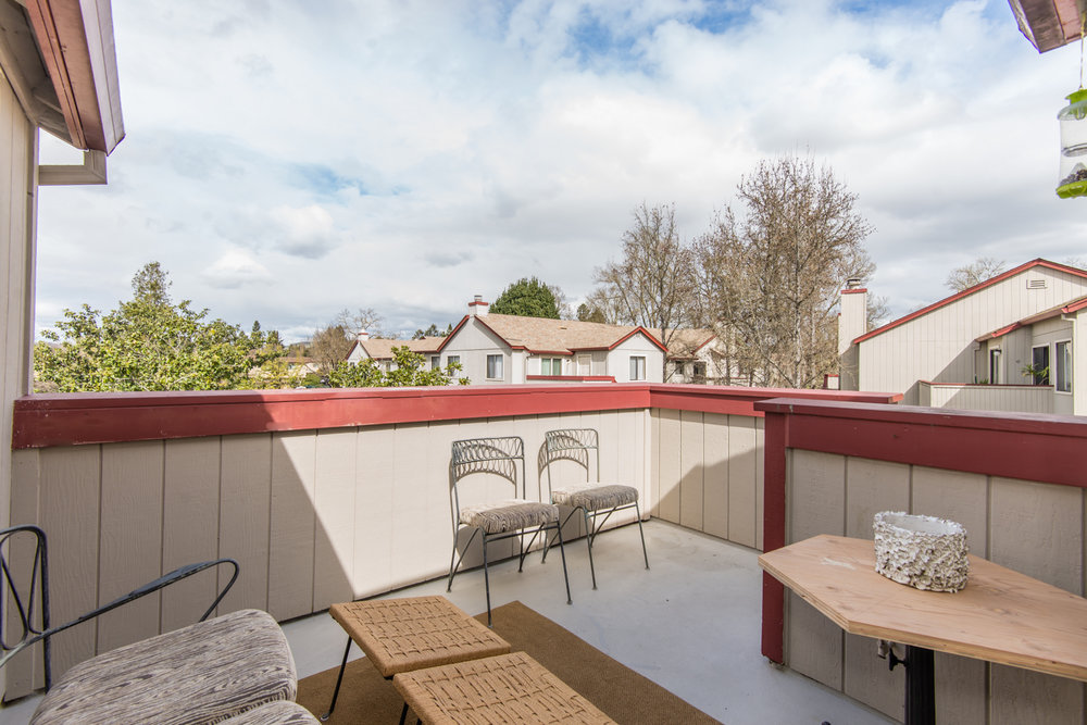 Private deck above 1 car garage provides additional entertaining space.