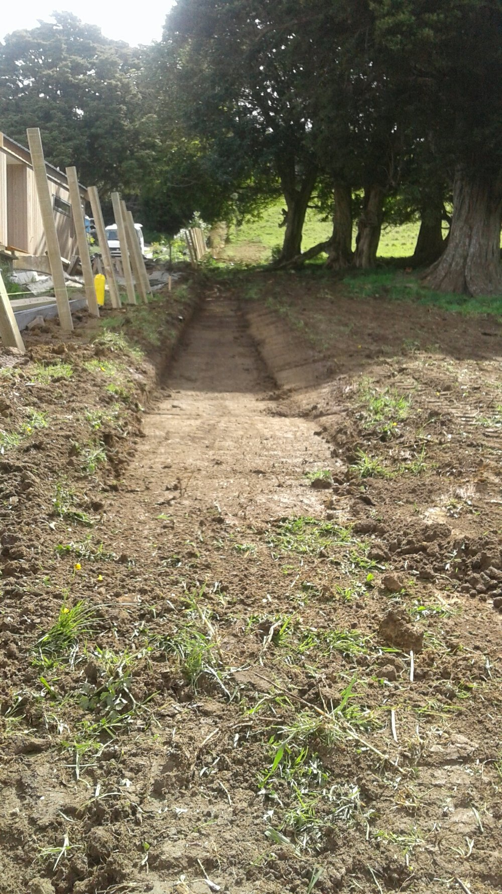 """Matakana: Swale Solution   When it rained, water ran through this property. No more water issues after the team constructed a """"swale"""" (an infiltration basin created to manage water runoff and improve rainwater control)"""