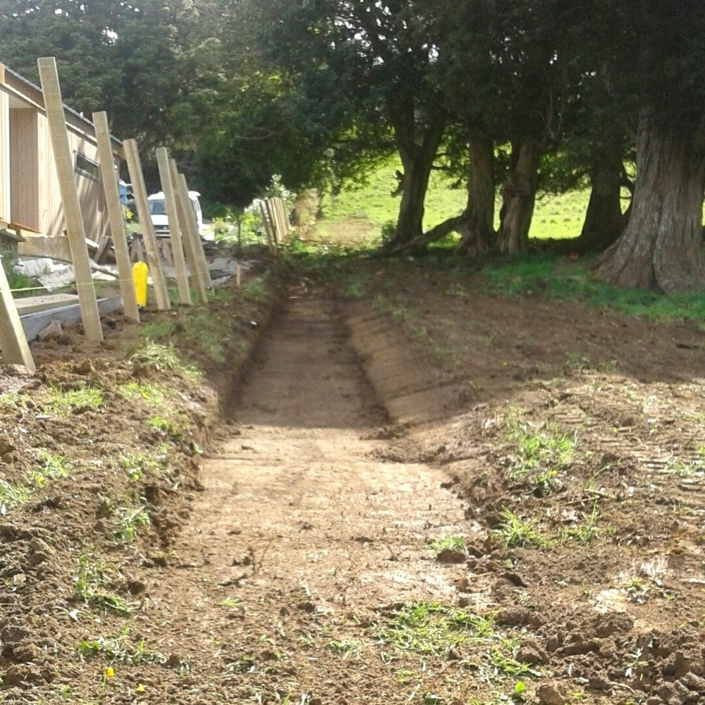 """Matakana: Swale Solution   When it rained, water ran through this property. No more water issues after the team constructed a """"swale"""" (an infiltration basin created to manage water runoff and improve rainwater control)."""