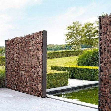 Decorative Wall or edging to create a courtyard  Image via  HERE
