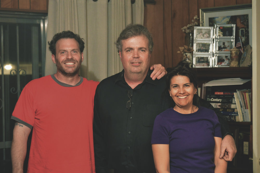 Paul (left) with his brother (middle) and wife (far right)