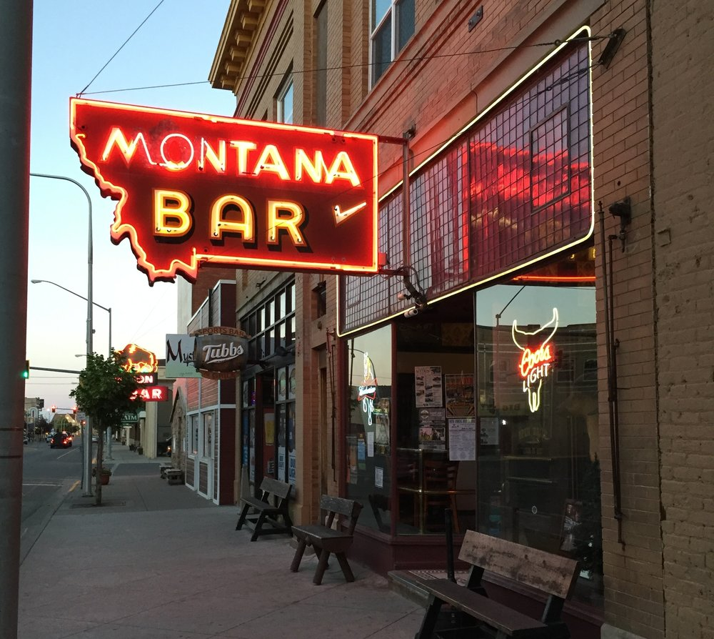 The Montana Bar's bright signs demand attention on Main St.