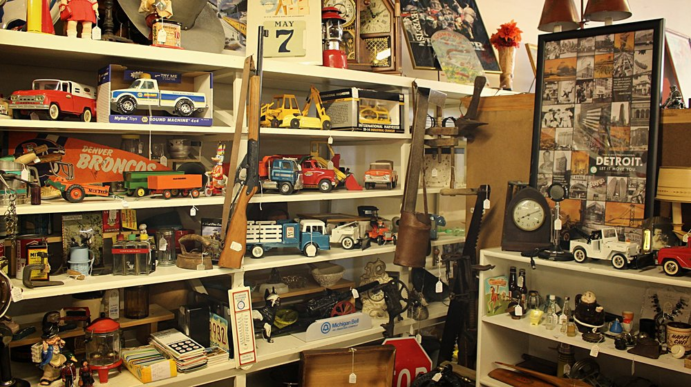 Trinkets and antiques fill the shelves of Jen's store