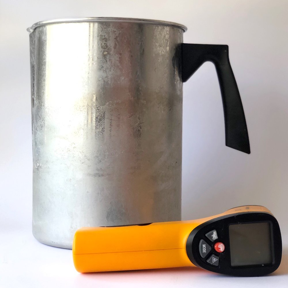 Metal pouring jug and digital thermometer