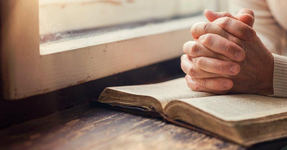 30026-Bible-handsfoldedonbible.1200w.tn.jpg