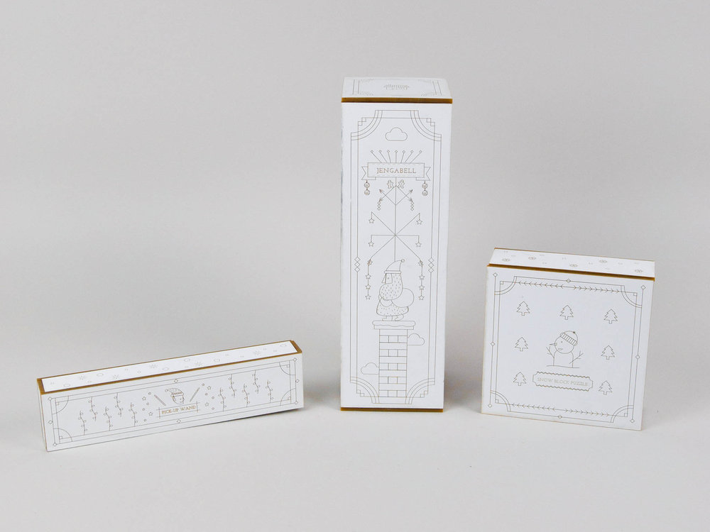 Toy packaging - This set of 3 packages are creates for traditional toys. They are Jenga, pickup sticks and puzzles. I used laser cut on acrylic to make it looks special. They are specific for Christmas, so I illustrated them with Christmas theme.Deliverables: Packaging Design, IllustrationArt Direction: Melissa Mcfeeters& Bryan Satalino