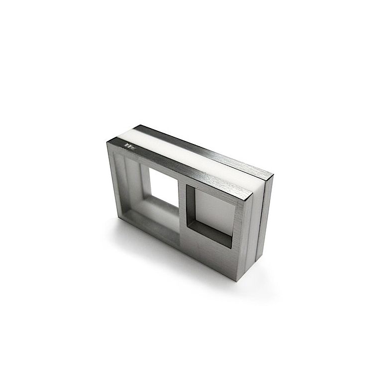 ColLECTION FOUR - _ 2009 _This collection, featuring geometry of square and cube as the main character, offers pieces displaying great strength and personality. Manufactured in corian, stainless steel and silver, the pieces from this collection have become a hallmark of the brand´s identity.