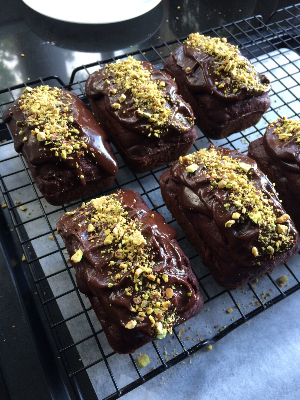 Chocolate Loaves - 8 loaves - $30Smothered with chocolate ganche and decorated with pistachios